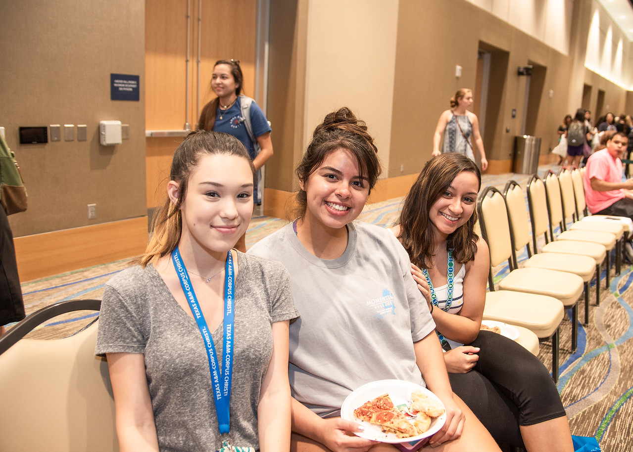 Tiffanie Vera (left), Monica Alvarez, and Mariel Martinez enjoy some pizza as they wait to hear from special guest speaker Justin Jones-Fosu held at the UC anchor ballroom as part of Islande ...