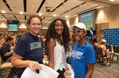 Tia Wigley (left), Tashara Swech, and Adrianna La Monthe collect goodies at the UC's anchor ballroom as a part of Islanders Night Out as they prepare to hear from special guest speaker Justin Jones-Fosu.