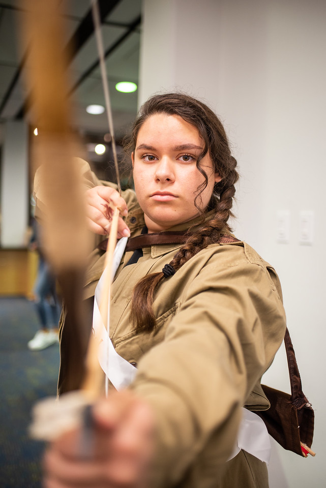 Emma Guerra as Katniss Everdeen for Banned Books week at the Mary and Jeff Bell Library