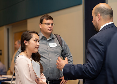 Arlene Castro (left) and Josh Warner listen to a recuiter from the Texas Department of Banking during the Business & Liberal Arts Career Expo.