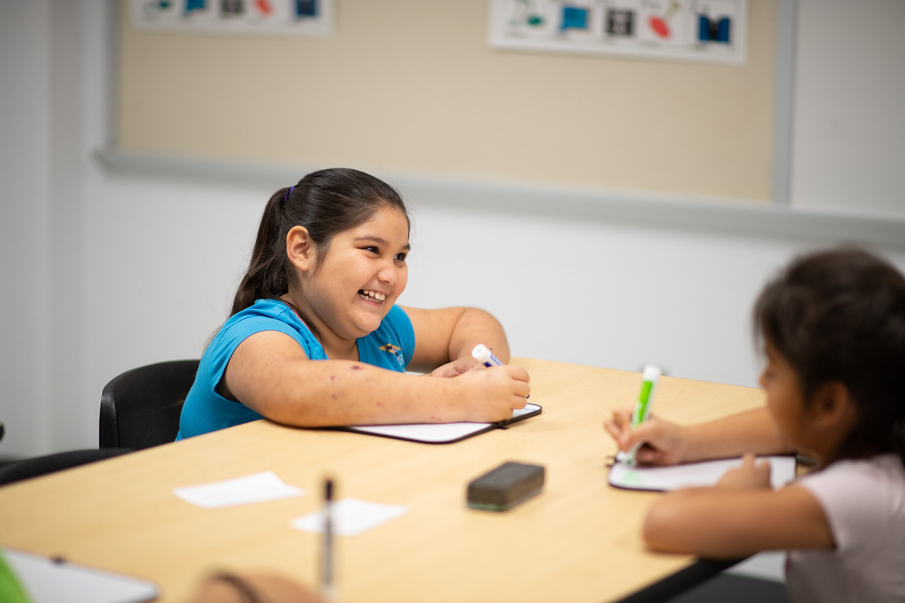 Zadie Gallegos (8) takes part in the tutoring session with TAMU-CC student Maddie Woods.