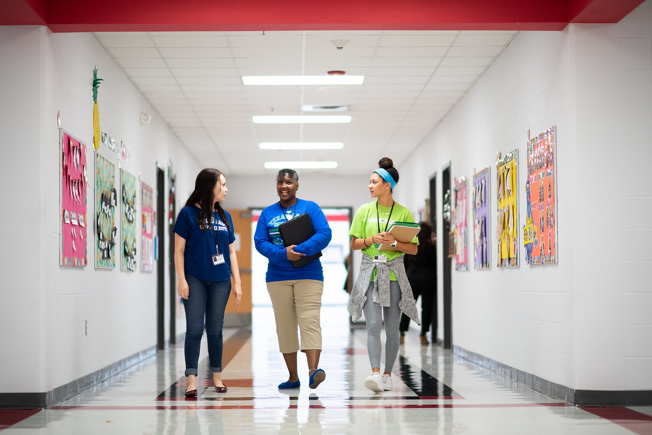 Kaela Mathis (left), Audrey Barnes, and Maddie Woods make their way to the tutoring room made available to them at Kennedy Elementary. The room is utilized to tutor students in literacy inst ...