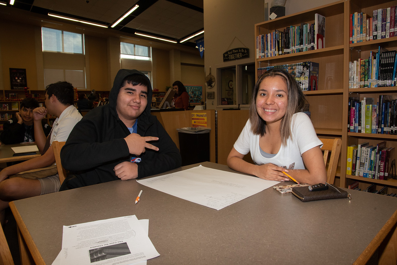 Lizette DelaRosa (right) with a West Oso High School student at the Spanish event at the library.