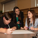 Mara Barbosa (middle) and Lauren Cook with a West Oso High School student at the Spanish event at the library.