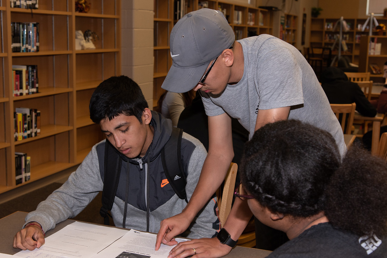 Fernando Rocha (right) with a West Oso High School student at the Spanish event at the library.