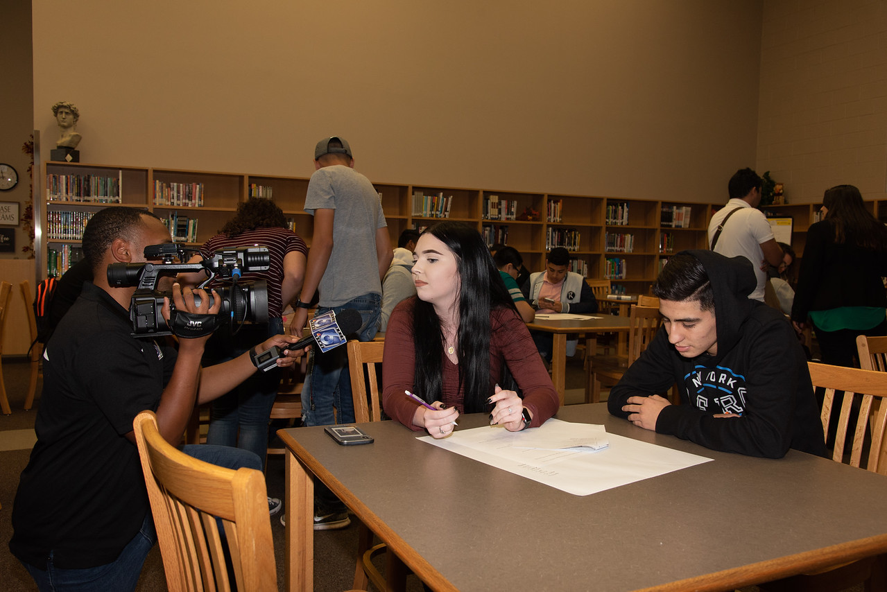 Faith Richards (middle) getting interviewed by channel 6 with a West Oso High School student at the Spanish event at the library.