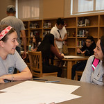 Veronica Fernandez (left) with a West Oso High School student at the Spanish event at the library.