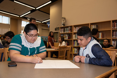 Justice Wallace (left) with a West Oso High School student at the Spanish event at the library.