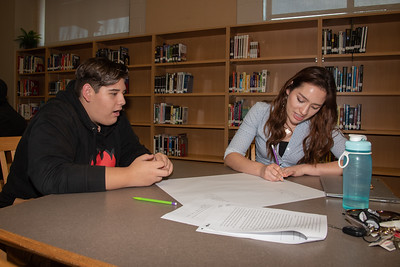 Lauren Cook (right) with a West Oso High School student at the Spanish event at the library.