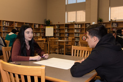 Faith Richards (left) with a West Oso High School student at the Spanish event at the library.