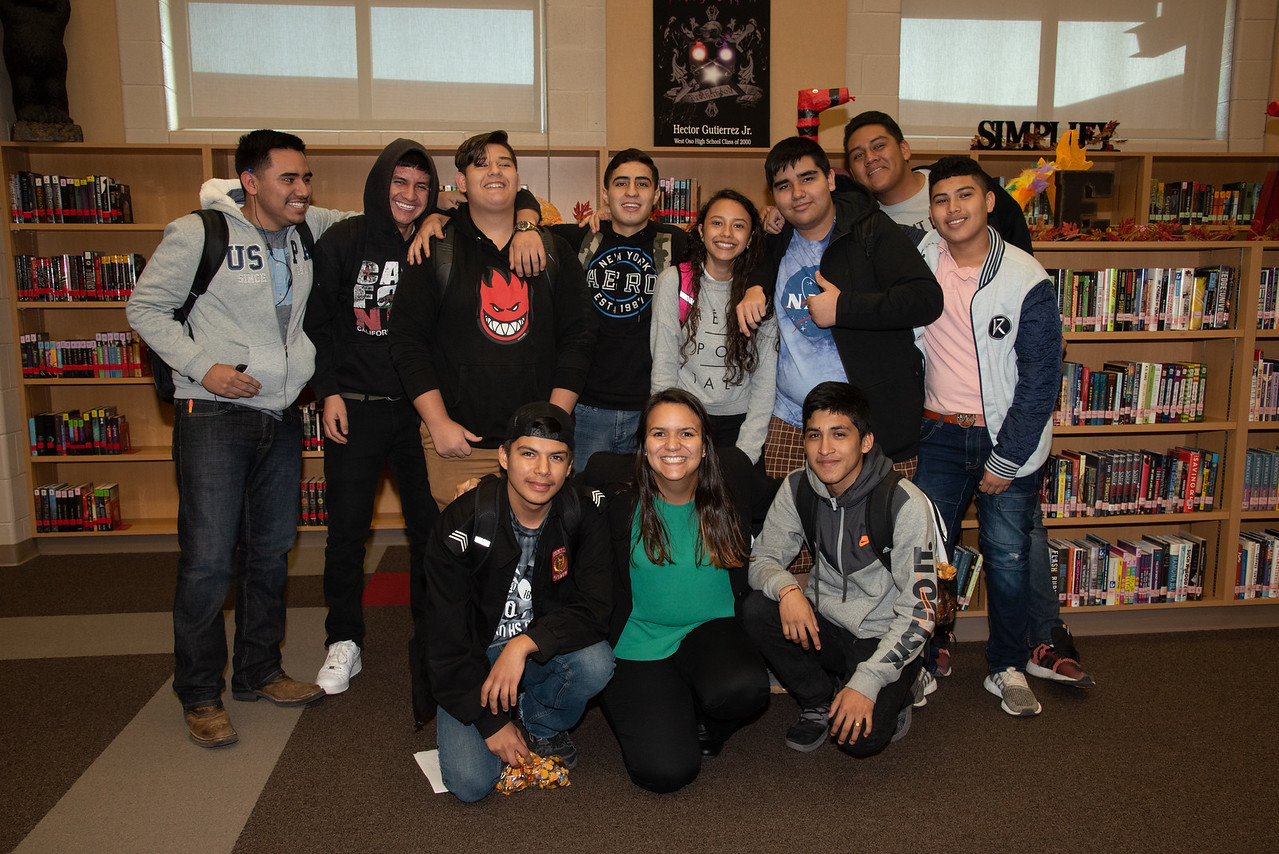 Mara Barbosa with West Oso High School students that are taking part of the Spanish event at the library.