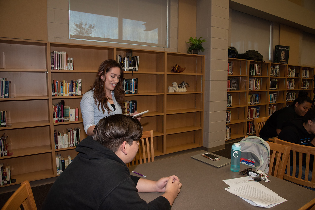 Lauren Cook (left) with a West Oso High School student at the Spanish event at the library.
