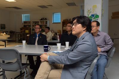 Taesic Kim listening to Pilwon Hur about robotics at the 2nd Southwest Asian Symposium.