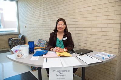 Mayra Alvarado registers people for the 2nd Southwest Asian Symposium.
