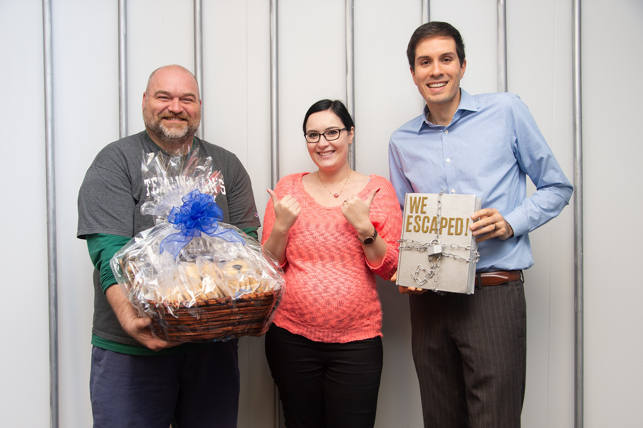 David Smith (left), Yuliana Zaikman, and Daniel Maitland are the winners of the Escape Room.