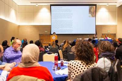People listen to Dr. Zobaida Nasreen at the international speaker event.