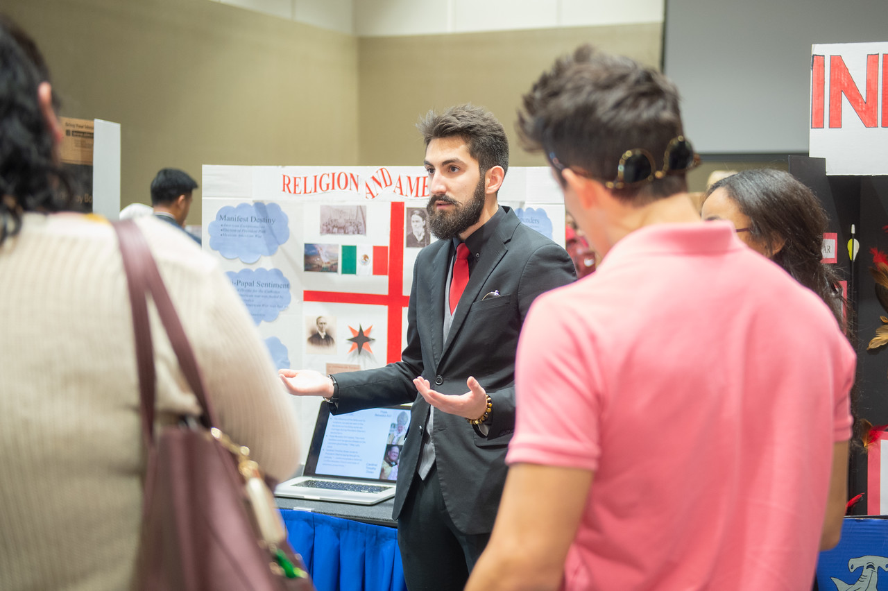 Fabian Farza (middle) at the first year symposium in the Anchor Ballroom.