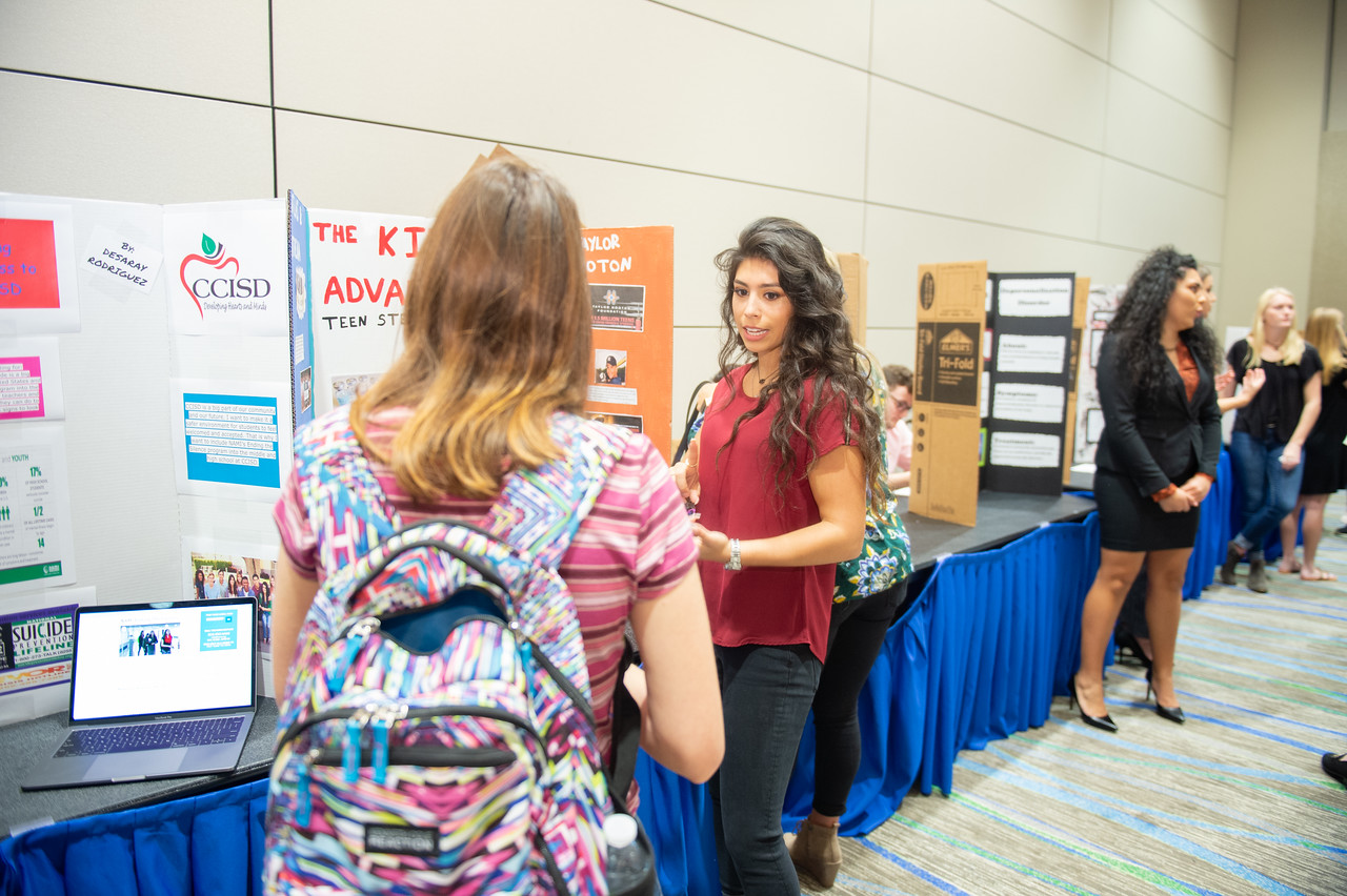 Kiara Alcoser (right) at the first year symposium in the Anchor Ballroom.