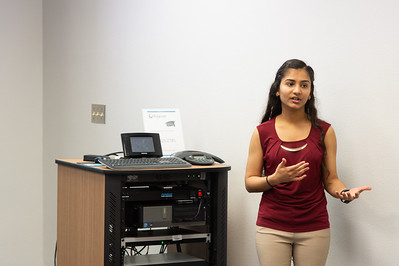 Krishna Patel giving her presentation at the Honors Symposium.