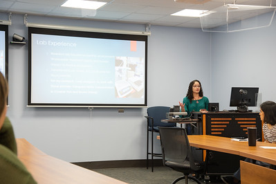 Sara Rodriguez (right) giving her presentation at the Honors Symposium.