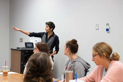 Carissa Pinon giving her presentation at the Honors Symposium.