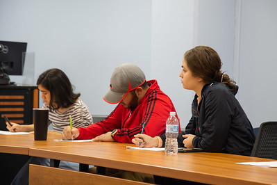 Students listening to Sara Rodriguez presentation at the Honors Symposium.