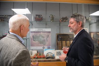 Dr. Philippe Tissot (right) reminisces with Dr. Gary Jeffress on experiences with surveying equipment displayed in the TAMU-CC's Conrad Blucher Institute.