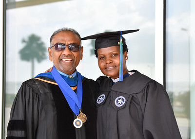Dr. Anantna Babbilli (left), and Julia Sambu pose for a photo before the Spring 2018 Commencement ceremony held on May 12, 2018.