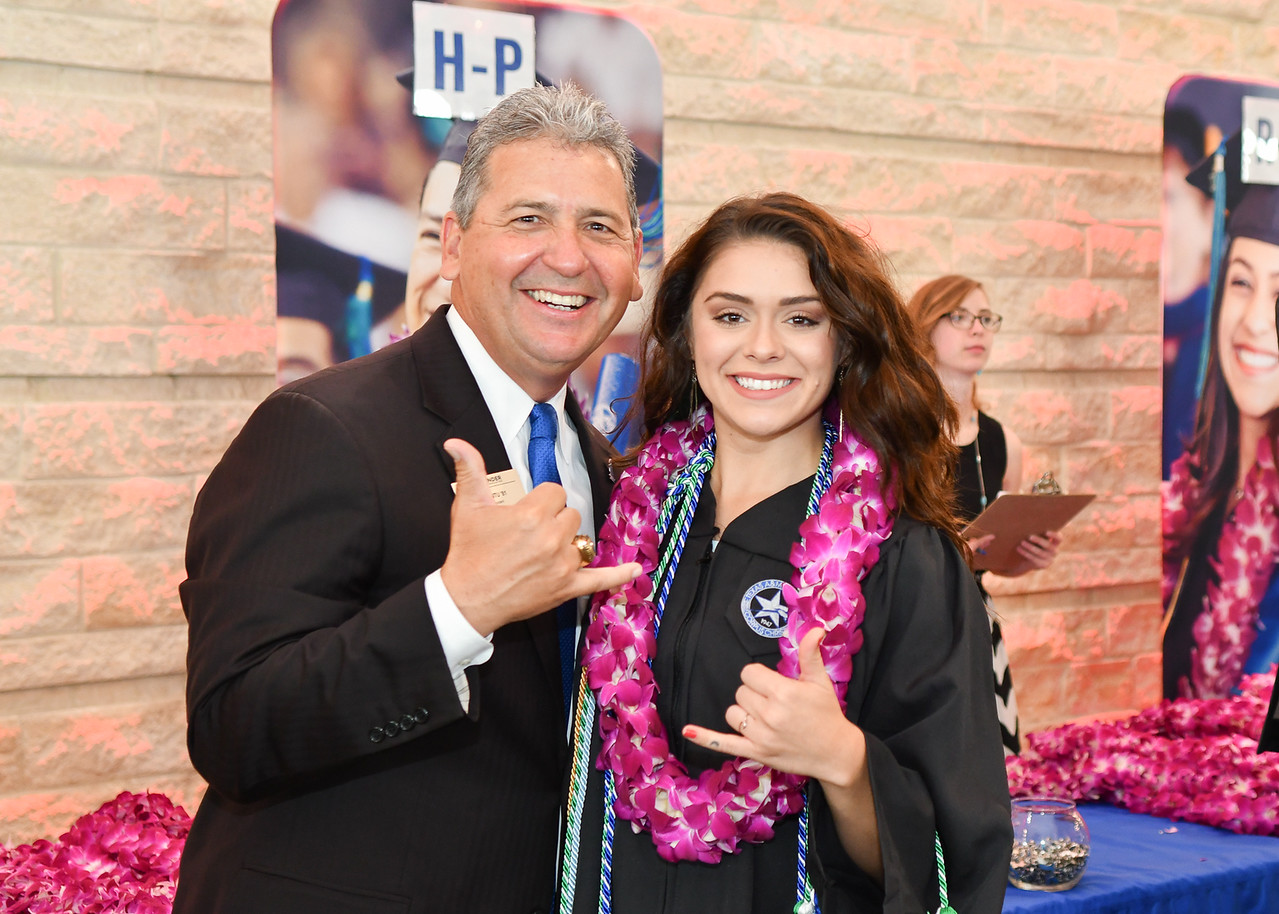 Ed Cantu (left) and Sierra Priest show their Islander pride before the Spring 2018 Commencement ceremony held on May 12, 2018.