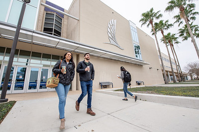 Alumni Morgan Benedict (left) and Bryan Benedict pass through Anchor Plaza on the first day of the Spring 2019 Semester.