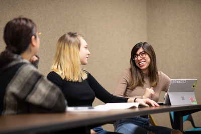 Alixandria Poer (right) catches up with classmates during the first day of the Spring 2019 Semester.