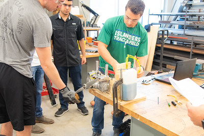 A group of students is working on their project at Dr. Robert R. Furgason Engineering Building.