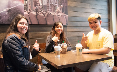 Dariana Cavazos(left), Yessenia Vazquez and Tho Nguyen are enjoying their starbucks before class.