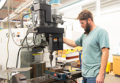 Travis Benton is working on his project at Dr. Robert R. Furgason Engineering Building.
