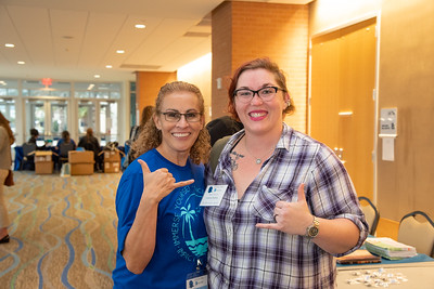 Alessandra Garcia and Lenora Perkins volunteer for the Women in Physics Conference.