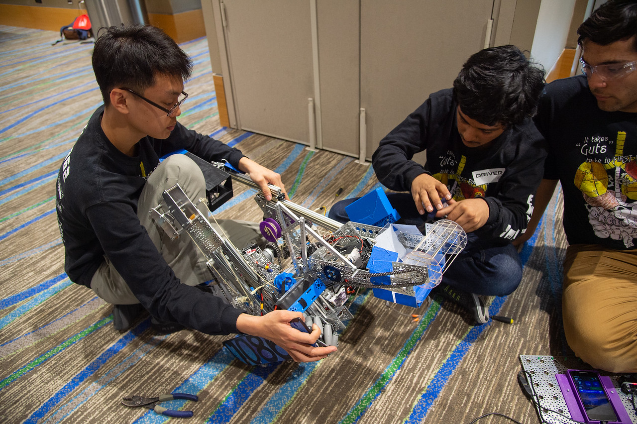 Team Droid Rage 2 repair their robot.