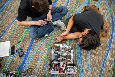 Team Jacket-Up make the final tweaks to their robot.