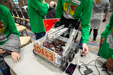 Team Droid Rage work on their robot before the competition.