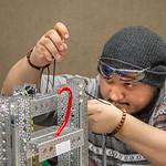 Roland Villarreal works on his robot.
