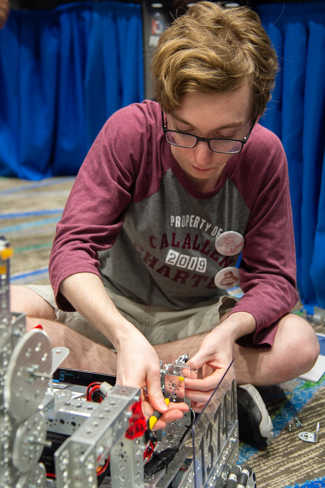 Brian Colburn of the Enginerds works on his robot before competition.