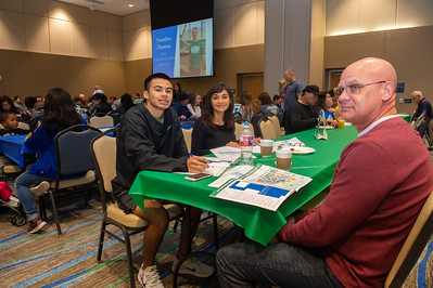 William Lack and his family plan out their day in the Anchor Ballroom.