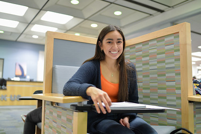 Sasha Salazar working on her Macro work at the Mary and Jeff Bell Library.