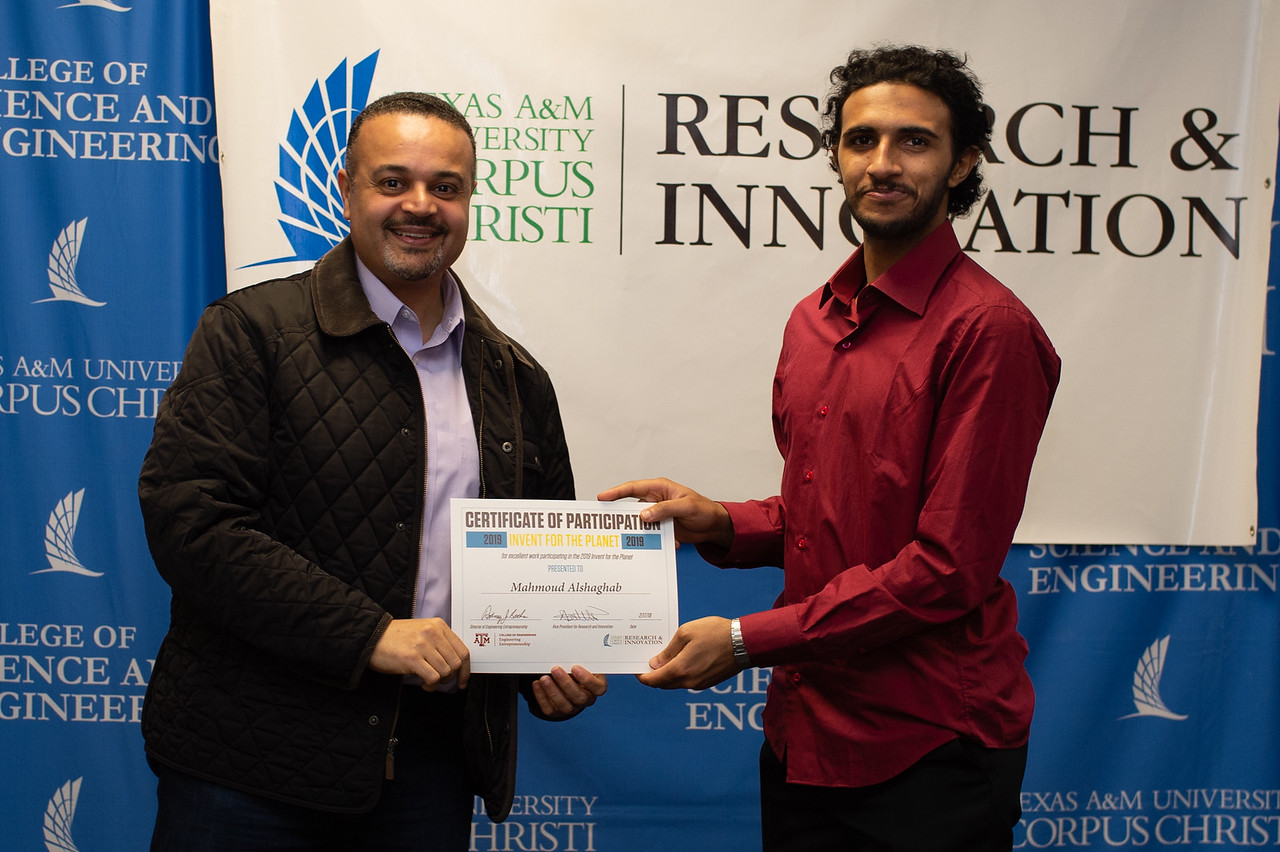 Mahmound Alshaghab receives his certificate of participation in Invent for the Planet.