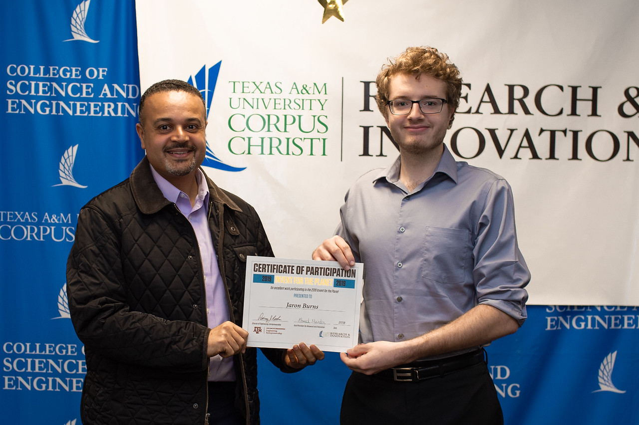 Jaron Burns receives his certificate of participation in Invent for the Planet.