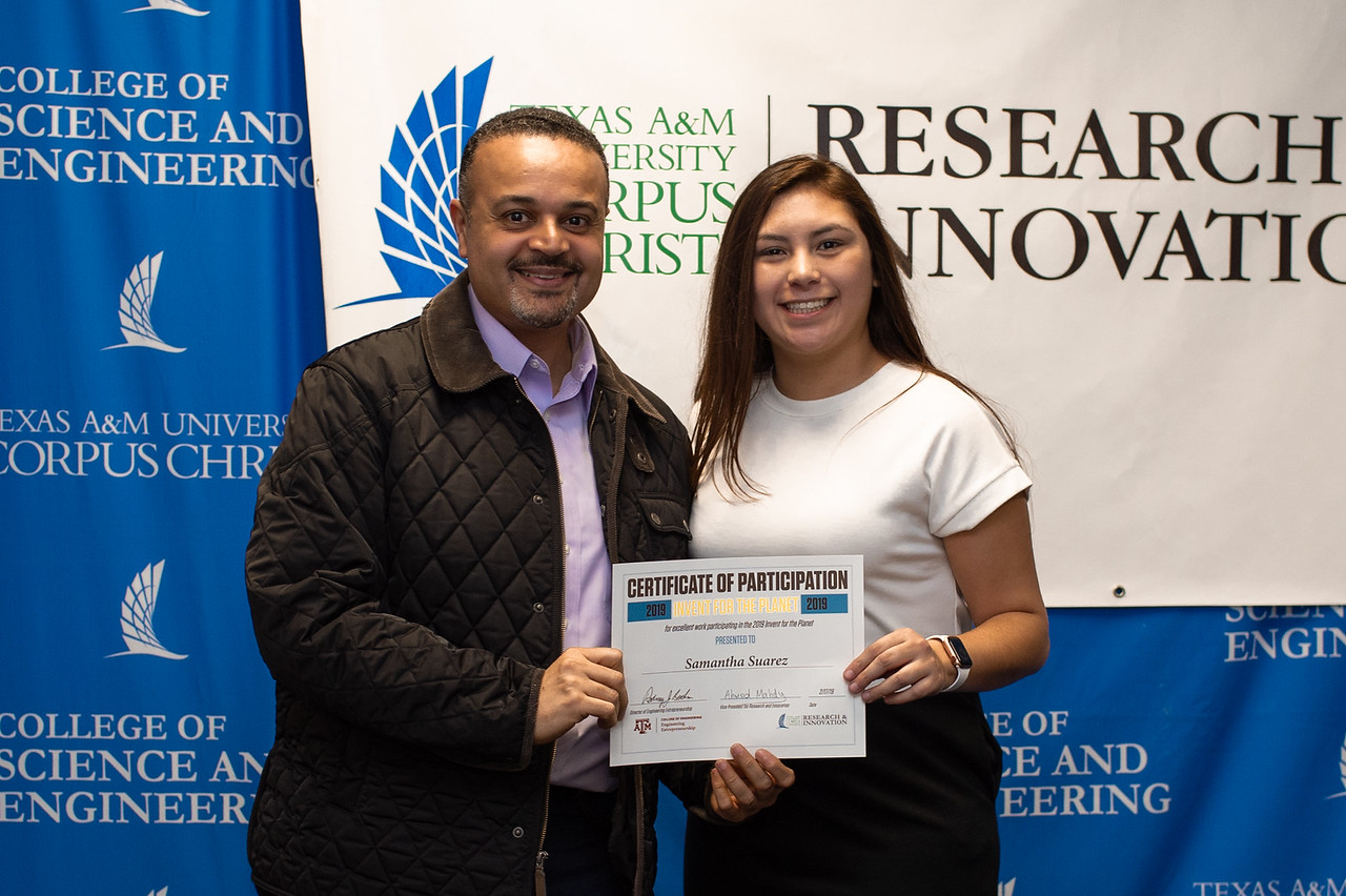 Samantha Suarez receives her certificate of participation in Invent for the Planet.