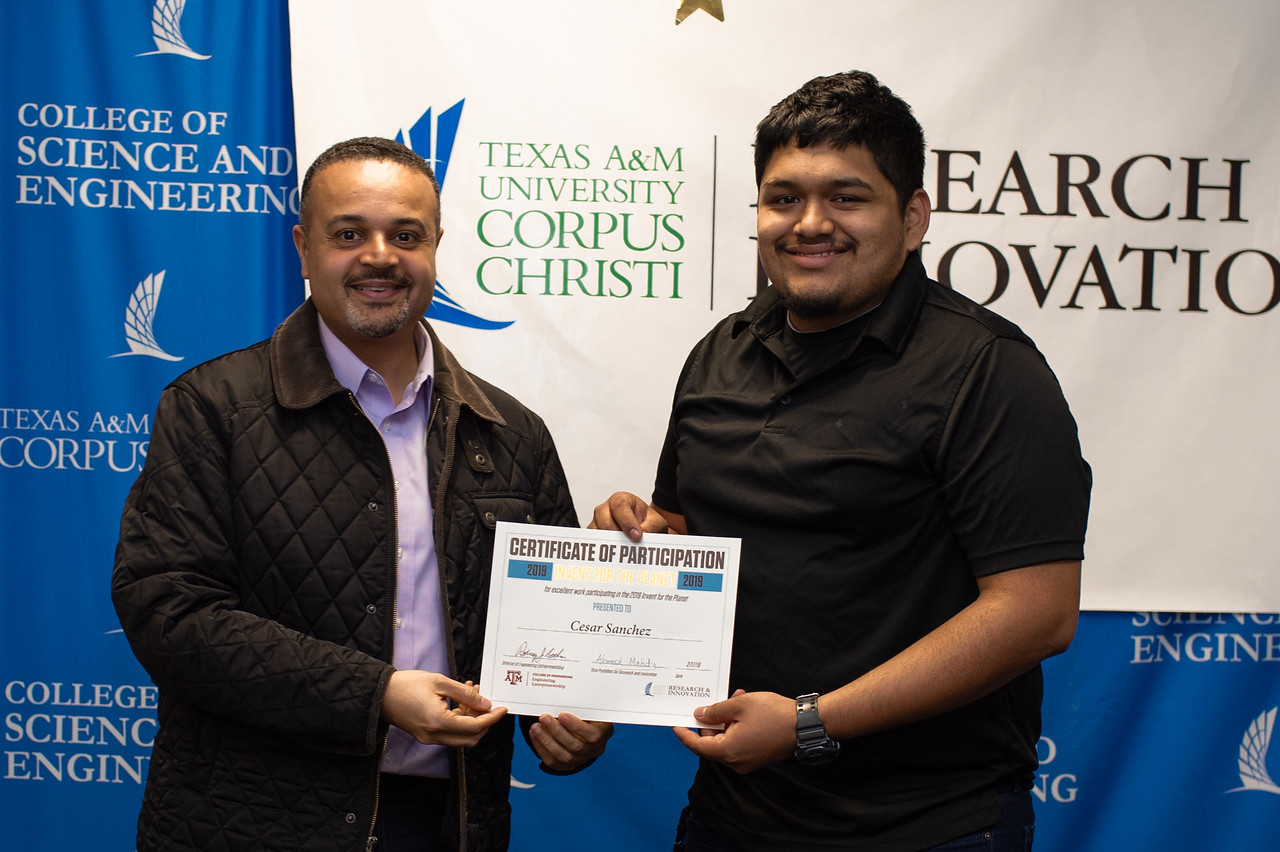 Cesar Sanchez receives his certificate of participation in Invent for the Planet.