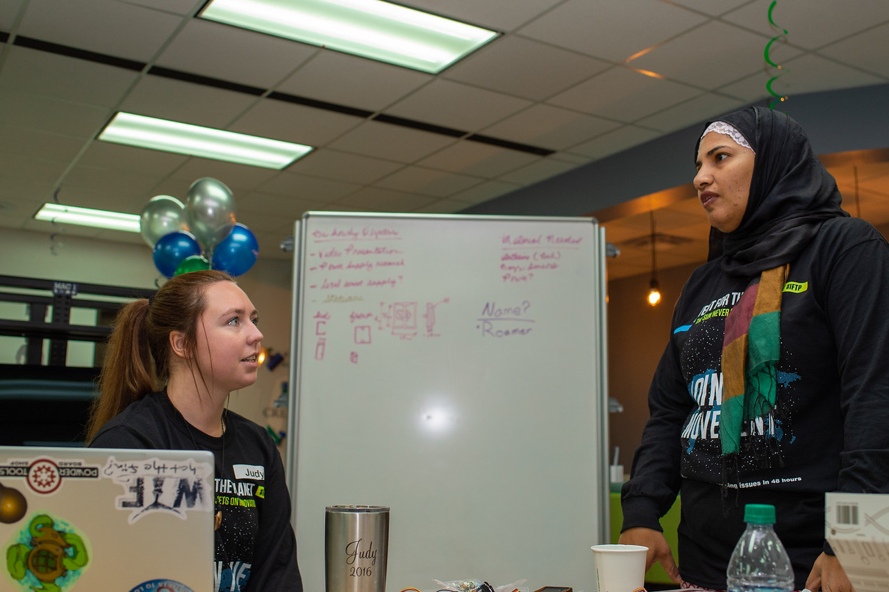 Dr. Sabeen Syed provides guidance for Judith Pope and Team Islander Inventors.