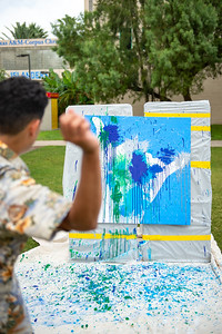 Hamza Mohammad relieves stress by throwing paint on East Lawn.