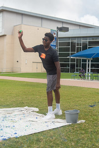 Arnold Omwoyo relieves finals stress on East Lawn.