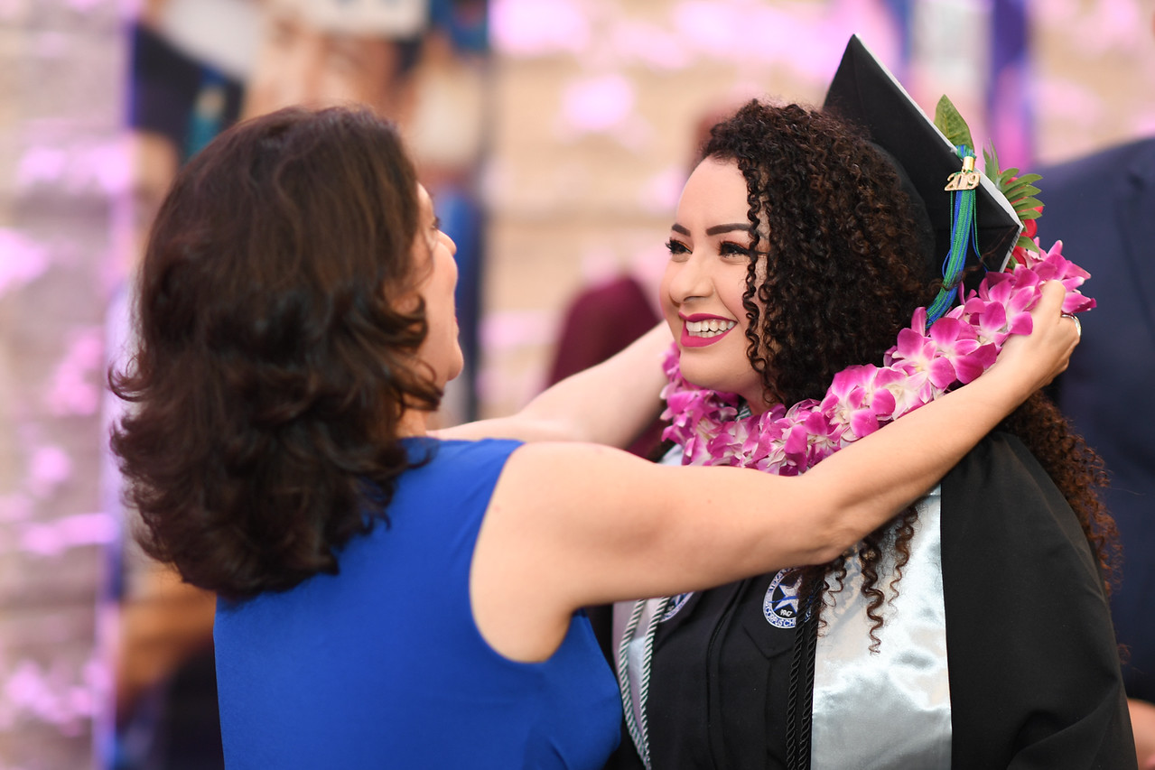 Islanders pick up their spring 2019 graduation lei from members of the National Islander Alumni Association.